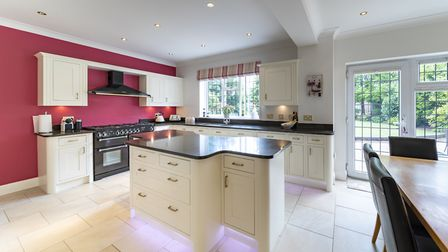 The bespoke kitchen boasts hand-painted units and a Rangemaster cooker. Picture: Daniels Estate Agen