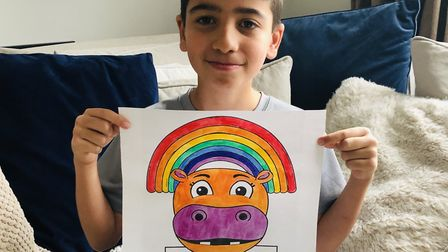 Preet's son Charlie proudly displaying his Hope the Hippo drawing for the St Albans Rainbow Trails c