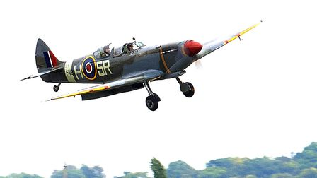 A Spitfire flying at the IWM Duxford showcase day on Tuesday, August 4. Picture: Gerry Weatherhead
