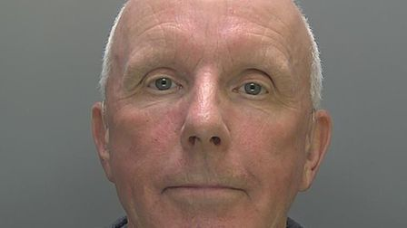 Charles Wixcey, 67, secretly recorded indecent videos of pupils and has been jailed for five years.