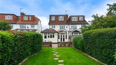 There is a beautifully maintained south-facing garden to the rear of the property. Picture: Collinso