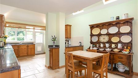 There is a large open plan kitchen with high ceilings and dining area. Picture: Collinson Hall