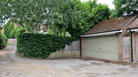 There is a double garage, plus additional parking for two cars. Picture: Druce