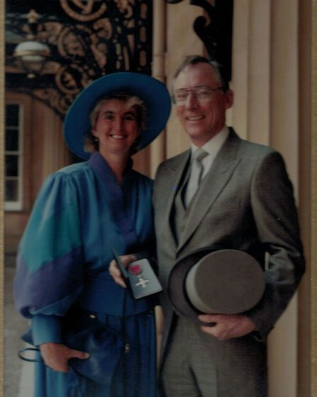 Ken Charles with Di receiving his MBE. Picture: Courtesy of Di Charles