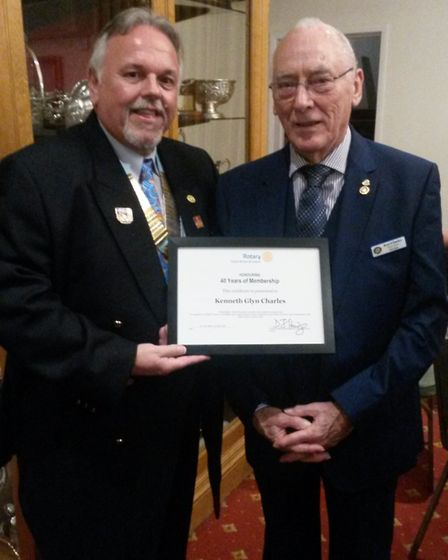 Ken Charles receives his certificate from district governor Dave Ford. Picture: Rotary Club of Royst