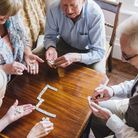 Playing board games and card games is very sociable and can help improve wellbeing. Picture: Getty I
