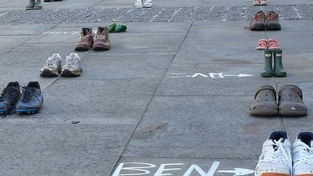 49 pairs of shoes were laid outside Pathfinder House in Huntingdon on Friday.