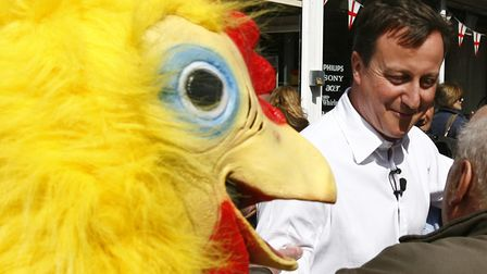 David Cameron walking around Tamworth in Staffordshire followed by a man dressed as a chicken. He is