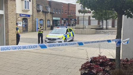 Police at scene of incident in Huntingdon High Street after reports of woman on roof.