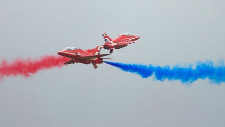 The Red Arrows crossover at the Flying Legends Air Show 2019 at IWM Duxford. The display team will a