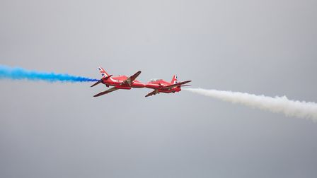 The Red Arrows perform a close pass at the Flying Legends Air Show 2019 at IWM Duxford. The display