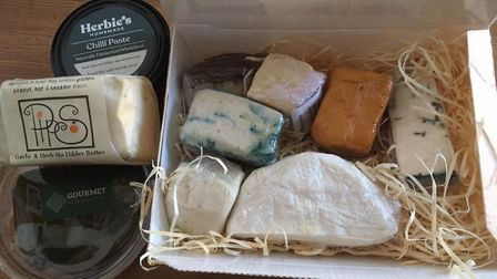 The Gourmet Alternative tasting box with a variety of vegan cheeses, as well as garlic and herb butt