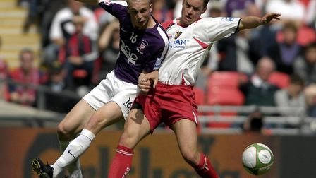 York City's Richard Brodie and Stevenage Borough's Gary Mills battle for the ball during the FA Trop