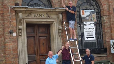 Members of Ramsey Rotary Club hung a banner in the town to let people know they are still operating.