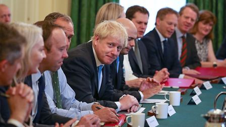 Boris Johnson sits down with his cabinet. (Photograph: AARON CHOWN/AFP/Getty Images)