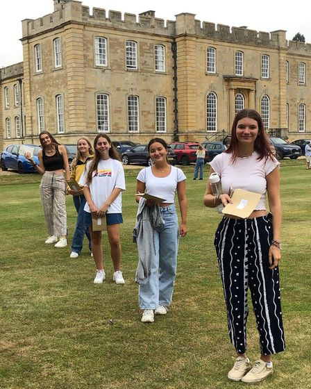 A-Level students celebrating at a social distance.