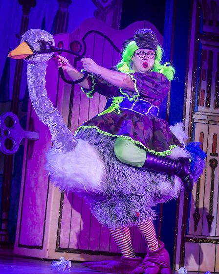 Bob Golding as Nurse Nellie on an ostrich in St Albans pantomime Sleeping Beauty at The Alban Arena.