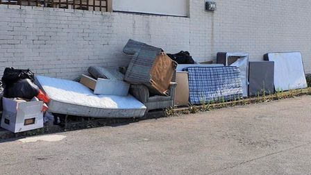 Mattresses, sofas, cupboards and bags of rubbish were dumped in a parking area on a Huntingdon estat