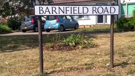 Members of the Marshalswick North Residents' Association were out in the heat to improve the road as