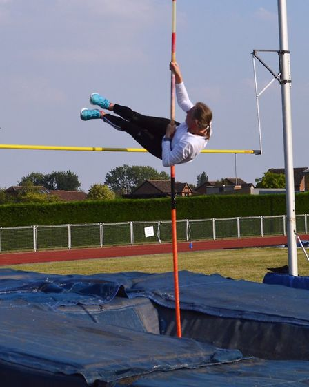 Huntingdonshire ACs' Sandra Pedley clears a club record in the pole vault.