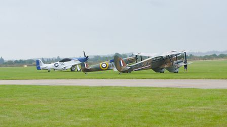 A P-51 Mustang, a Spitfire Mk1e and the DH Dragon Rapide awaiting on the decision to fly at the IWM