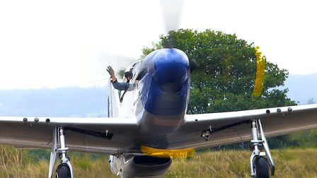 Pilot John Dodd brings the P-51 Mustang 'Miss Helen' back to the chocks after a great display in dif