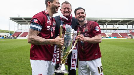 Marc Richards (left) was part of the Northampton Town team that lifted the League Two championship t