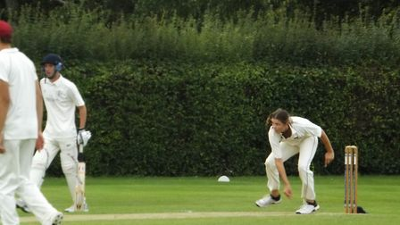 Lucy Barrett bowling for Waresley during her three-wicket spell against Longstanton.