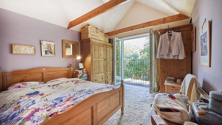 The main bedroom enjoys far-reaching views over the village and Heartwood Forest. Picture: Frost's