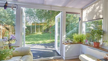 The private rear garden is beautifully tended. Picture: Frost's