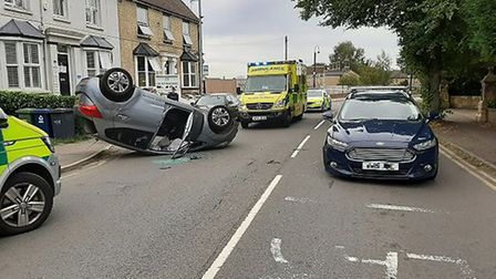 The car on its roof on Brampton Road this morning (Thursday).