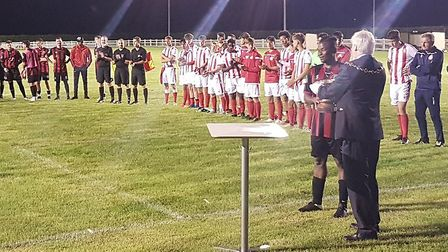 Huntingdon Town receive the Mayors Cup after their victory over Stevenage.