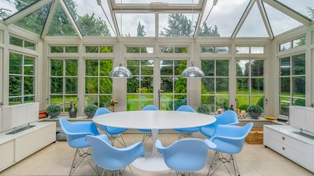 The conservatory serves as a spacious dining area. Picture: Whittaker & Co