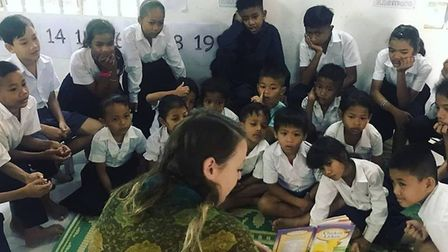 Hannah Harries from Whaddon volunteers at a school in Cambodia, working with many orphaned children