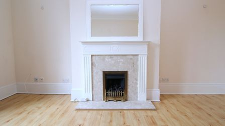 The living room has a feature fireplace with gas flame fire. Picture: Daniels Estate Agents
