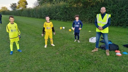 Needingworth u-11s receive kit and equipment donation. Picture: PAUL GIBBONS