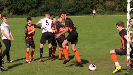 A Brookmans Park Res defender clears a Welwyn Warriors Res shot off the line, Picture: BRIAN HUBBALL