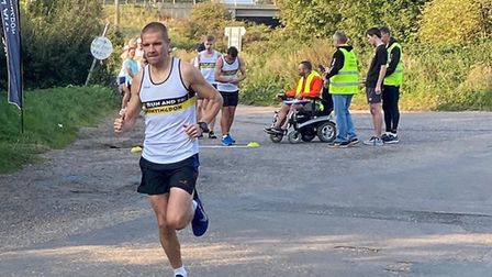 Dave Hudson of BRJ Run & Tri in the club's 10K race it or pace it event.