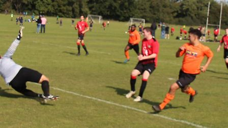 Callum Baylis scores the first of his two goals for Brookmans Park against Six Bells. Picture: BRIAN