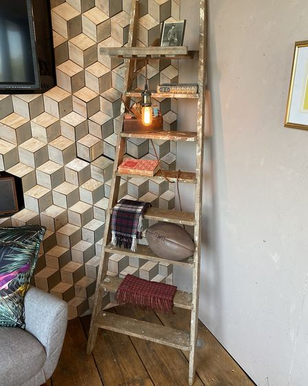 This upcycled wooden ladder makes a cool shelf. Picture: PA Photo/Max McMurdo