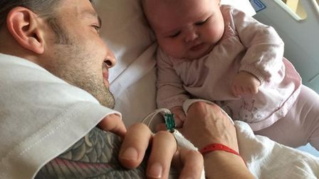 Ben George with daughter Taylor. He is raising awareness of a rare brain condition.