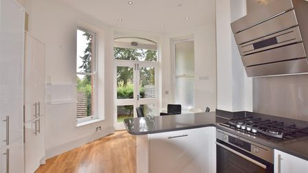 Features of the kitchen/breakfast room include granite work surfaces and double glazed sash-style wi