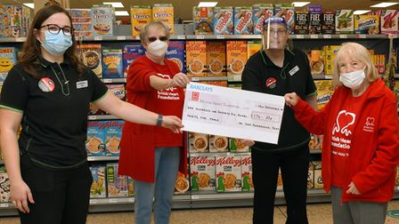 Staff at the Co-op in St Ives hand over a cheque to the St Ives branch of the British Heart Foundati