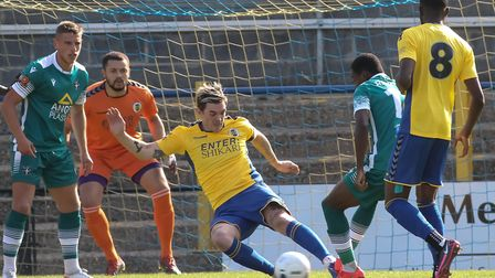 Tom Bender clears for St Albans City in their pre-season friendly against Sutton United. Picture: JI