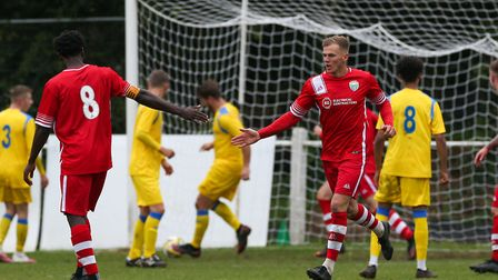Andrew Simmons of London Colney celebrates scoring the second goal in the match between Harpenden To