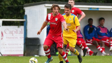 Jack Mace of London Colney under pressure from Nathan McGreevy of Harpenden Town in the match betwee