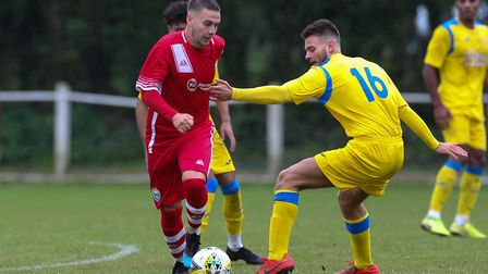 Antony Stockman of London Colney cuts inside Ben Quarrington-Carter of Harpenden Town in the match b