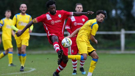Issac Olaleye of London Colney brings the ball down in the match between Harpenden Town and London C