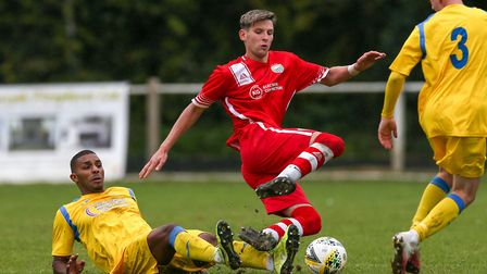 Theodore Costa of London Colney is fouled by Chris Cordara-Soanes of Harpenden Town in the match bet