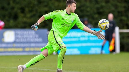 Lee Axworthy of London Colney kicks clear in the match between Harpenden Town and London Colney. Pic